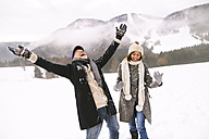 Happy senior couple in the snow - HAPF02230