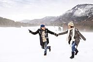 Senior couple having fun in snow-covered landscape - HAPF02233