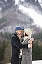 Happy senior couple in winter landscape - HAPF02239
