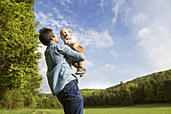 Father holding happy baby in the nature - HAPF02299