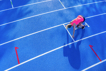 Top view of female runner in starting position - STSF01330
