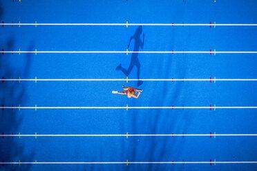Top view of female runner on tartan track - STSF01333