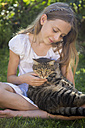 Girl with cat in garden - SARF03391