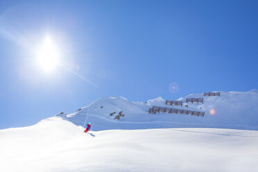 Austria, Bludenz, skier in powder snow - MMAF00167