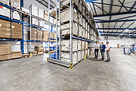Business people meeting in company storehouse - DIGF02959