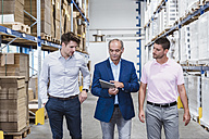 Business people meeting in company storehouse - DIGF02962