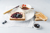 Toast with blueberry jam and cup of tea - MYF01978