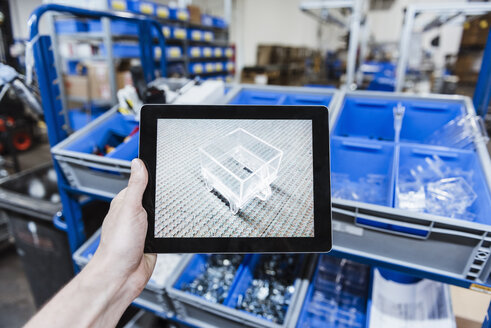 Hand holding digital tablet with image of a product - DIGF03030