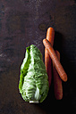 Sweetheart cabbage and carrots on dark background - CSF28402