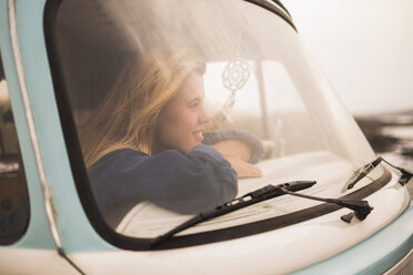 Spain, Tenerife, young woman sitting in van looking out of windscreen - SIPF01826