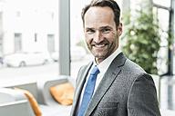 Portrait of smiling businessman - UUF12094