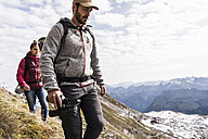 Germany, Bavaria, Oberstdorf, two hikers walking in alpine scenery - UUF12119