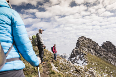 Germany, Bavaria, Oberstdorf, hikers in alpine scenery - UUF12122