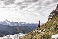 Germany, Bavaria, Oberstdorf, hiker in alpine scenery - UUF12128