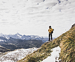 Germany, Bavaria, Oberstdorf, hiker in alpine scenery - UUF12137