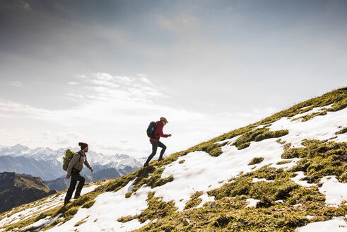 Germany, Bavaria, Oberstdorf, two hikers walking up alpine meadow - UUF12164