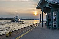 Germany, Hamburg, Mooring area Neumuehlen, Towboat, Elbe river at sunset - KEBF00666