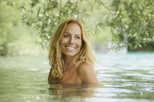 Portrait of laughing blond woman bathing in lake - PNEF00228