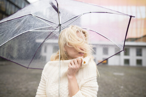Woman with umbrella on a rainy day - PNEF00234
