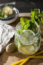 Glass of detox water with mint, ginger, rosmary and limes - CSTF01415