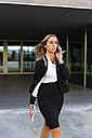 Walking businesswoman on the phone - MGIF00196