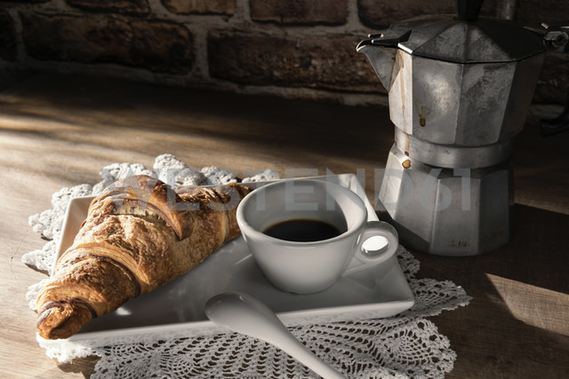 Cup of espresso and a Croissant - CSTF01433