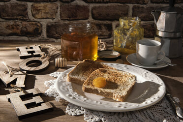 Breakfast table with toast, orange marmalade, honey and espresso - CSTF01436