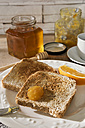 Breakfast table with toast, orange marmalade, honey and espresso - CSTF01439