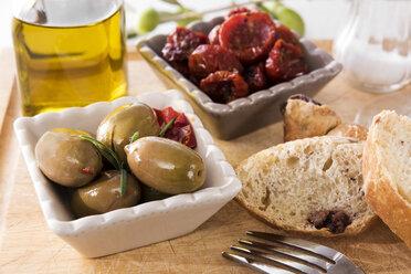 antipasti, pickled olives, pickled tried tomato, olive bread, olive oil and salt - CSTF01453