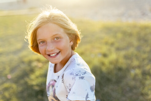 Portrait of happy blond girl at backlight - MGOF03679