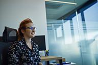 Smiling businesswoman in office - ZEDF00941