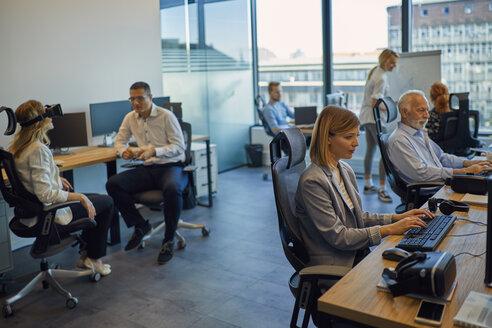 Colleagues working in office - ZEDF00953