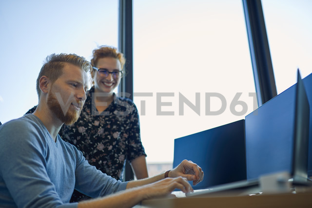 Two colleagues working together in office - ZEDF00965