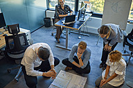 Business team brainstorming in office - ZEDF00971