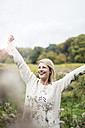 Portrait of happy blond woman outdoors - MOEF00247