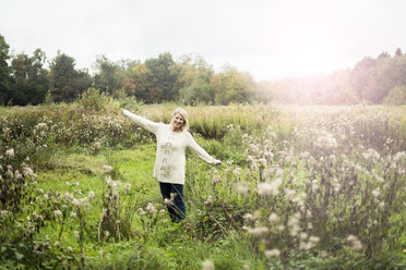 Portrait of happy blond woman in the nature - MOEF00250