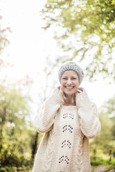 Portrait of happy woman in the forest in autumn - MOEF00256