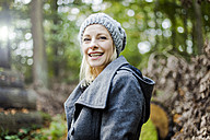 Portrait of happy woman in the forest in autumn - MOEF00262