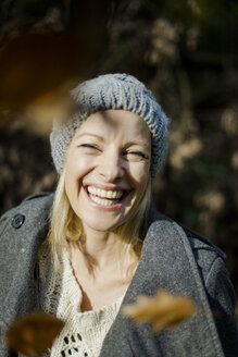Portrait of happy woman in the forest in autumn - MOEF00265