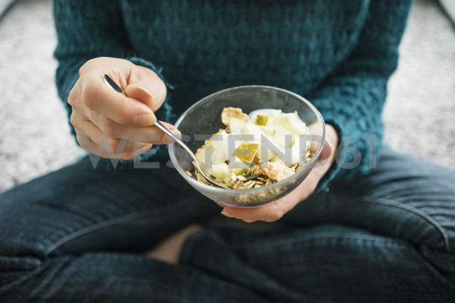 Close-up of woman eating fruit muesli - MOEF00277