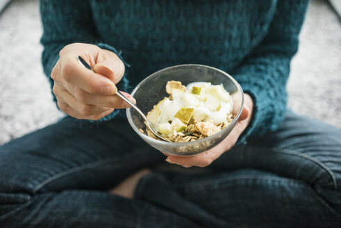 Close-up of woman eating fruit muesli - MOEF00277