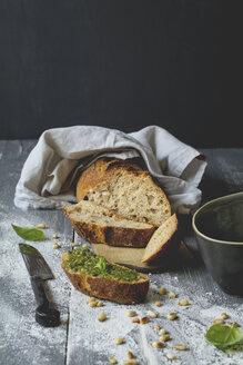 Homemade basil pesto, rye baguette on wood - ODF01560