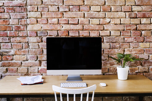 Workspace at brick wall in office - HAPF02338
