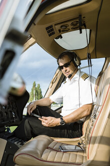 Portrait of pilot in cockpit of a helicopter - OJF00199