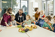 Group of children and teachers preparing fruit in kindergarten - MFF04070