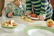Close-up of toddlers etaing apples in kindergarten - MFF04073