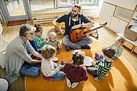 Children and teachers singing and making music in kindergarten - MFF04082