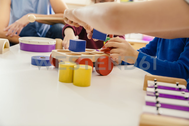 Close-up of children playing with musical instruments and toys in kindergarten - MFF04091 - Mareen Fischinger/Westend61