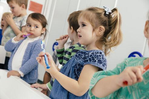 Children brushing their teeth in bathroom of a kindergarten - MFF04100
