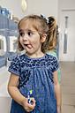 Portrait of girl with toothbrush in bathroom of a kindergarten - MFF04103